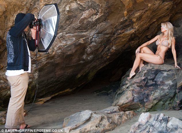 Working the camera: The reality star was seen perched on a rock as she showed off her new designs