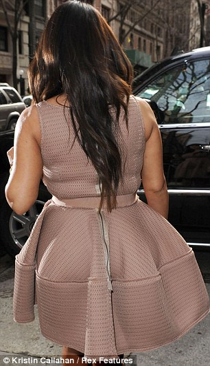 Experimenting with maternity wear: Kim's dress was made of thick material which cinched in at the waist
