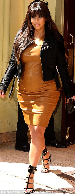 Strutting her stuff: Kim managed to expertly strut around in her heels despite the long day