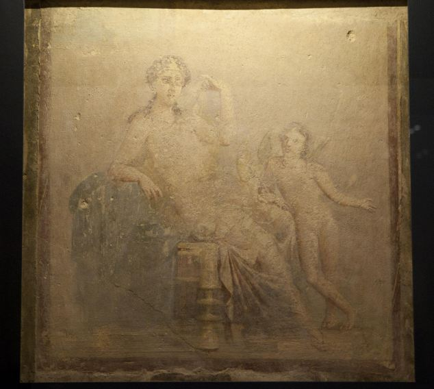 Undamaged: A fresco showing Venus and Cupid was found in the ruins of Pompeii