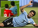 Luis Suarez punches Gonzalo Jara in the face