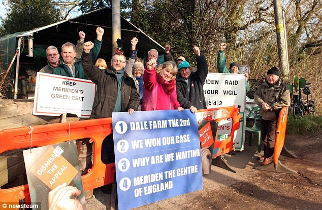 Victory: Protestors celebrate at their encampment after it was decided that a gypsy camp on their doorstep in Meriden, Warwickshire, has got to go