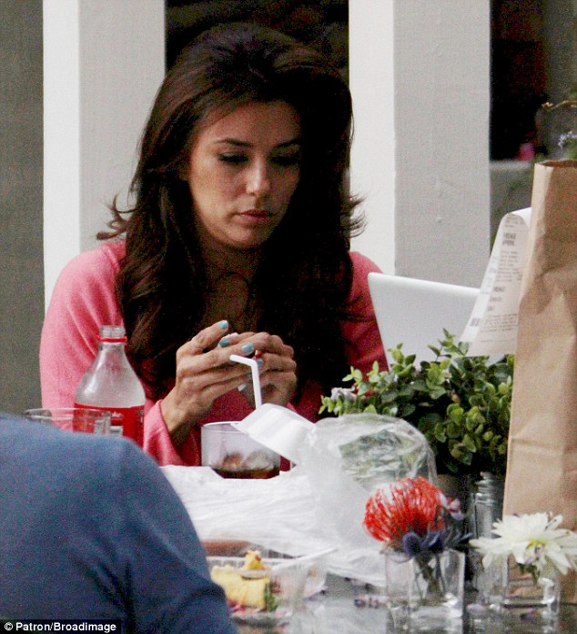 Grubs up: The star had a relaxing lunch during her day of pampering, taking it easy during a break in her hectic schedule