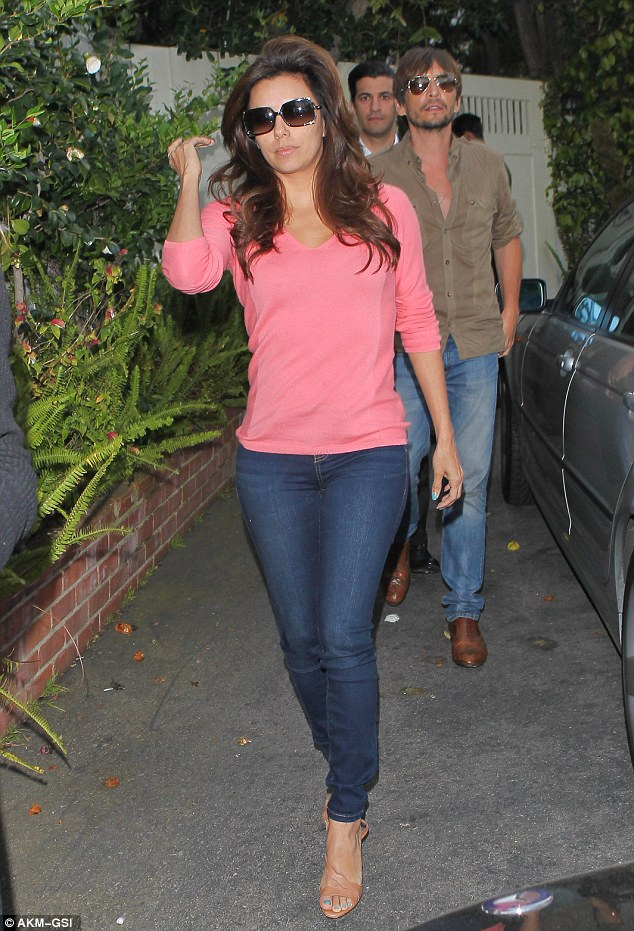 Perfectly coiffed: Eva Longoria left friend Ken Paves' Hollywood salon on Tuesday after he'd tended to her tresses