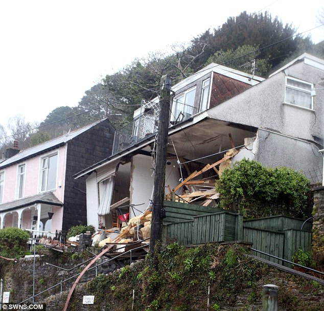 Distraught: The body of Susan Norman, 68, was found after Veronica Flats in Sandplace Road, Looe
