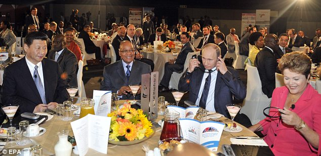 Dinner: The Russian leader with China's Xi Jinping, Jacob Zuma of South Africa and Brazilian president Dilma Rousseff