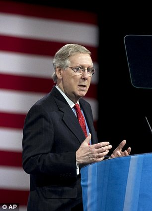 Senate Minority Leader Mitch McConnell of Ky. stands next to a stack of documents as he speaks at the 40th annual Conservative Political Action Conference in National Harbor, Md., Friday, March 15, 2013