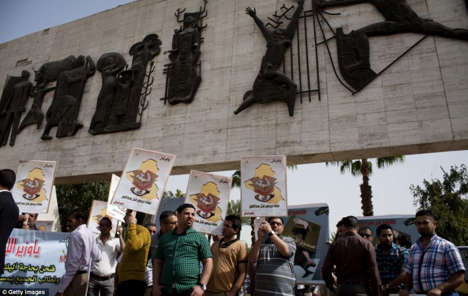 New world: Iraqi government employees hold a peaceful protest in Baghdad's Tahrir Square