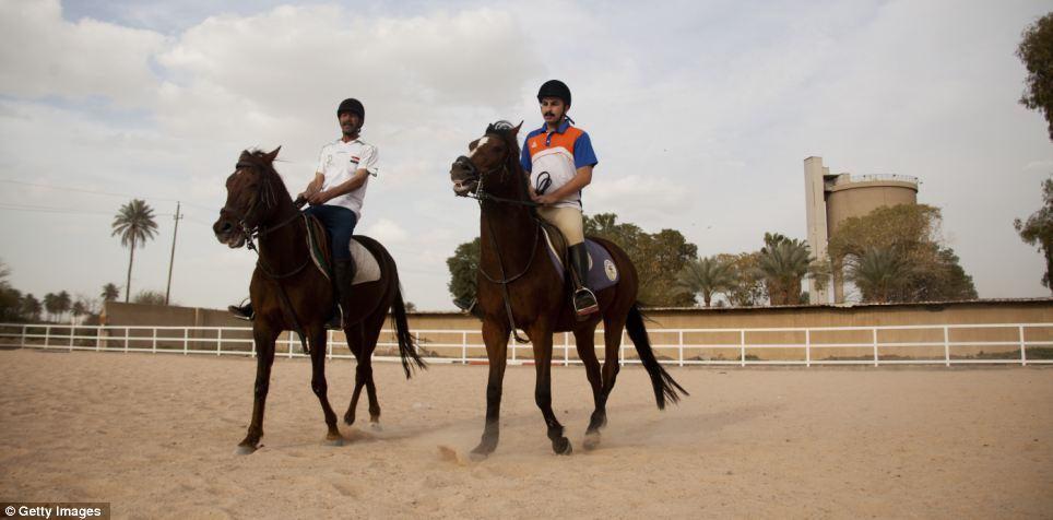 Progress: Ali Hasan and Ali Satar ride horses for pleasure in the upscale district of Karada ten years on