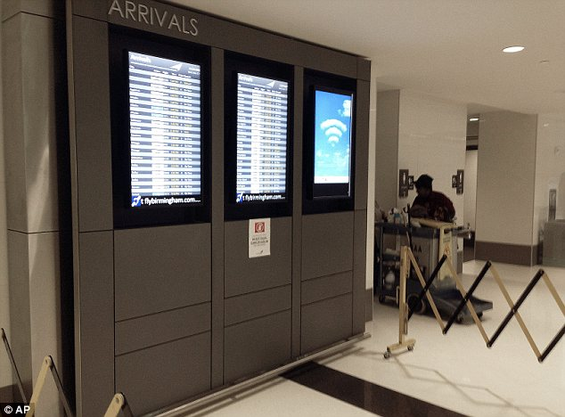 Outrage: Despite Friday's accident, a video monitor cabinet similar to the one that fell on Friday still exists - with a 'don't touch' sign and a barricade in front of it