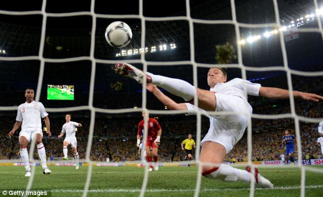 Over the line? John Terry makes a key clearance in England's 1-0 win over Ukraine at Euro 2012