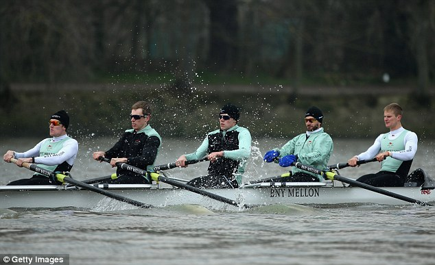 Wrapped up: Milan Bruncvik (second right), 28, was also wearing gloves in training with his Cambridge crew