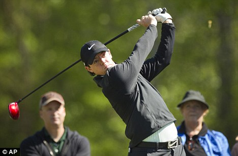 Raring to go: Rory McIlroy tees off on the second hole during the pro-am