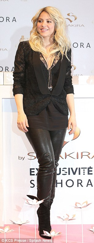 Quite risque: The new mother paired the leather trousers with a lowcut top that resembled a lacy black bra