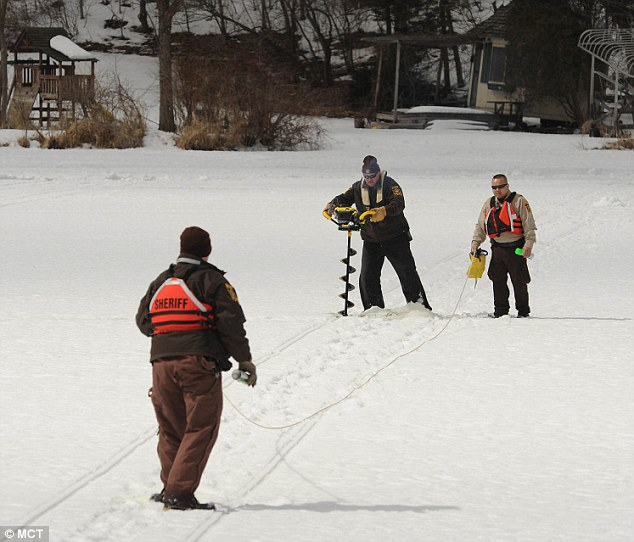 Deep probe: Holes are drilled into the ice on Keller Lake in search of Kira Trevino in Maplewood, Minnesota