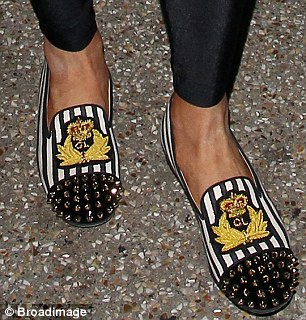 Royally spiky: The former child star wore striped flat loafers with a crest and studs on them