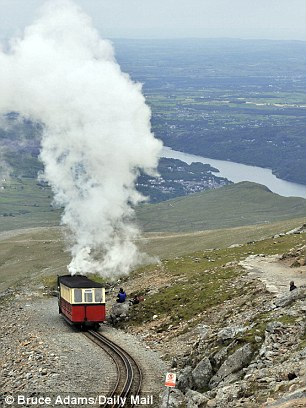 In better weather: The Snowdon Mountain Railway in North Wales is pictured in June 2009