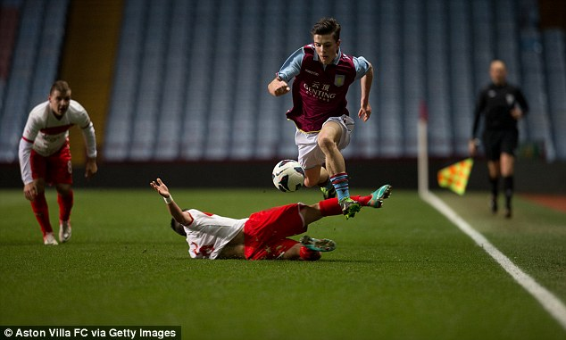 Can't catch me: Jack Grealish skips over Emmanouil Siopis of Olympiakos in the quarter-final