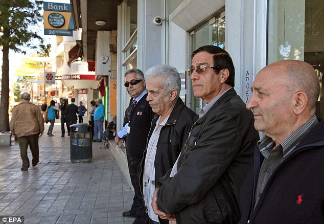 Not impressed: People wait outside a branch of the Bank of Cyprus, in Nicosia, Cyprus