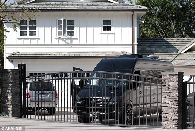 Making amends? Justin Bieber's van was spotted outside his ex girlfriend Selena Gomez's house, where he reportedly spent just over an hour on Wednesday