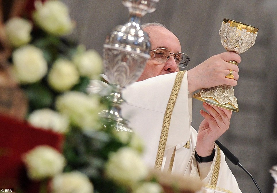 Blessing: The Pope celebrates the Holy Communion during the service