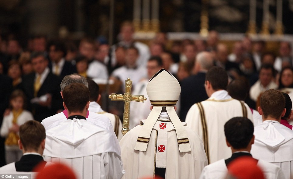 Ceremony: Pope Francis is pictured leaving after conducting his first Chrism Mass inside St Peter's Basilica on the morning of Holy Thursday