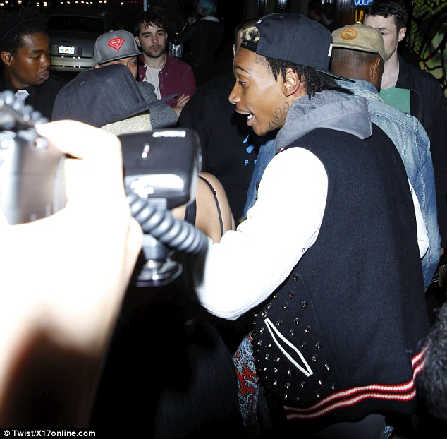 Let's go! Wiz assisted his fiance Amber to the car after a night out at Hyde Lounge in Hollywood