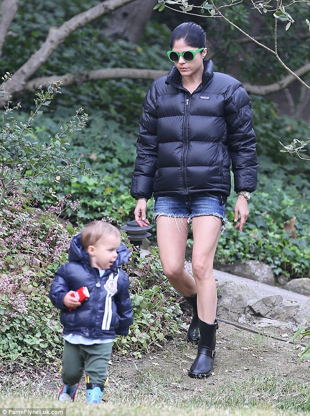 She's got legs: Selma showed off her shapely limbs in cut offs during playtime in the park with her 20-month-old son Arthur on Tuesday