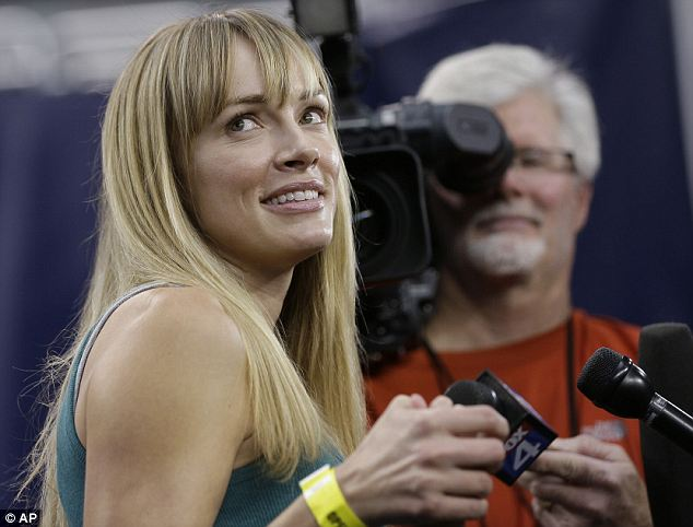 Star off the court: Amanda Enfield, the wife of the Florida Gulf Coast coach Andy Enfield, has earned a good deal of attention due to her model looks