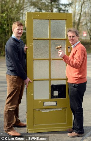 Auctioneers Henry Meadows and Chris Albury (red top) from Dominic Winter Auctioneers, South Cerney with 1950's front door which is the actual front door from Paul McCartney's childhood home
