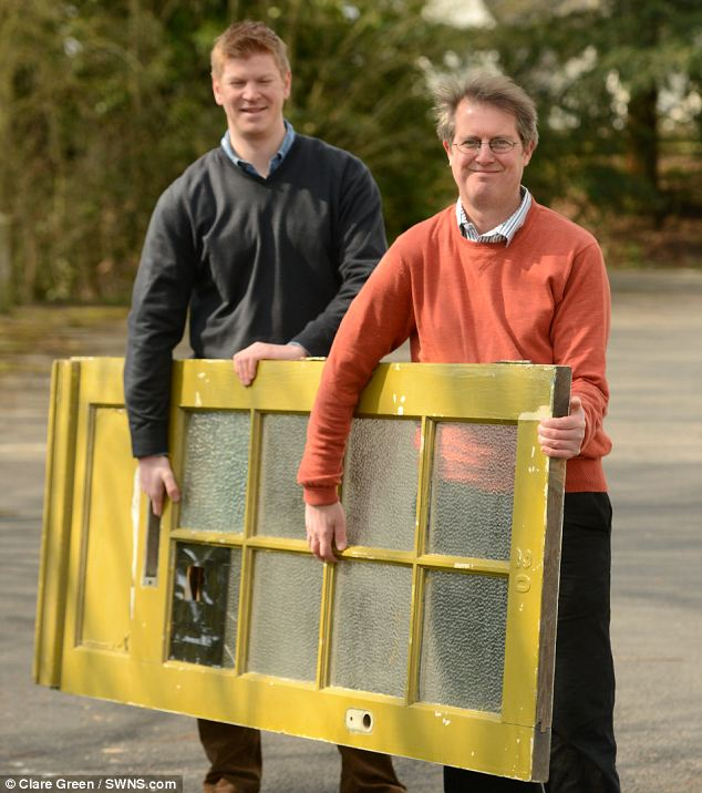 Relic: Auctioneers Henry Meadows and Chris Albury (right) from Dominic Winter Auctioneers with Fifties front door which is from Paul McCartney's childhood home, 20 Forthlin Road, Allerton