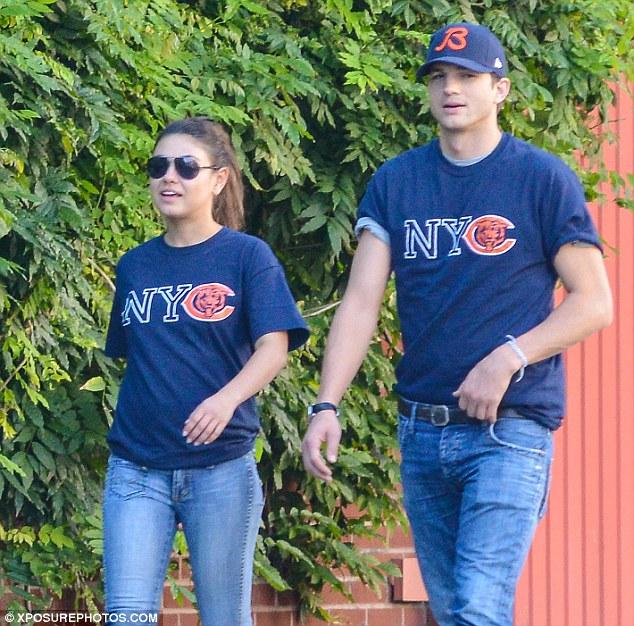 Diehard fans: Ashton and his girlfriend Mila Kunis showed their support of their beloved Chicago Bears in New York in September