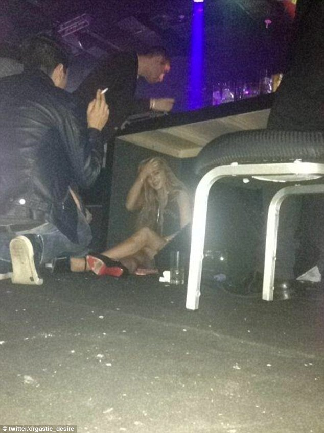 Long night? Lindsay Lohan was snapped reclining under a nightclub table in Sao Paulo, Brazil on Thursday night after attending the opening of John John Denim clothing store