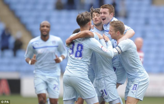 Lifting the gloom: Coventry City's Cyrus Christie (unseen) celebrates scoring the only goal in the win over league leaders Doncaster