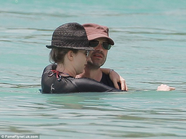 He's all romance! Jimmy and Karoline take a dip in clear blue ocean - it emerged last June that he was paying just 1 per cent income tax