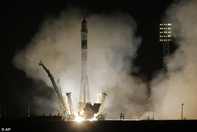 The Soyuz-FG rocket booster with Soyuz TMA-08M space ship takes off carrying Cassidy and his crew mates to the International Space Station