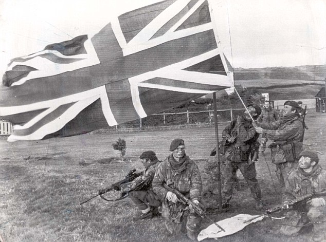 Bloody battle: British forces fly the Union flag over Port Howard, West Falkland during the conflict. An estimated 650 Argentines, 255 British servicemen and three islanders died in the 1982 conflict