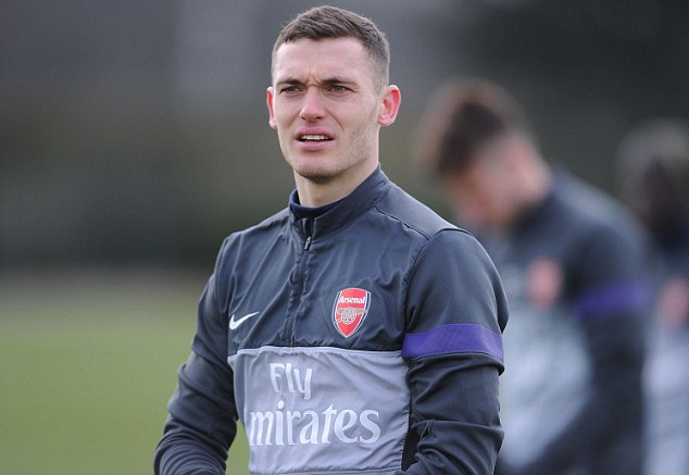 In training: Axed Thomas Vermaelen is desperate to win his place back in the Arsenal line-up