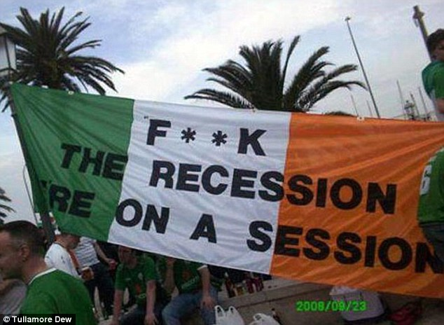 Telling it like it is: These Ireland fans emblazoned a defiant message across their flag