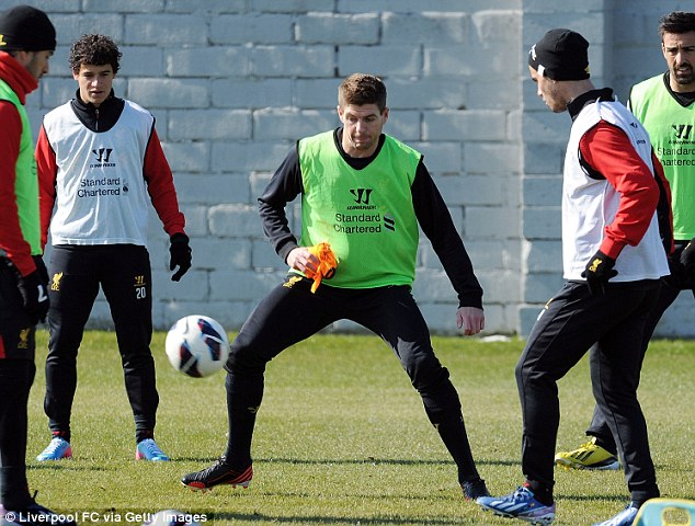 On the scene: Gerrard (centre) back training with Liverpool on Friday morning after England duty