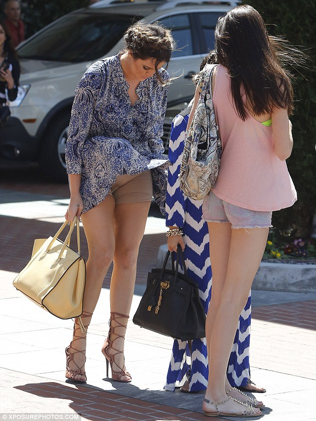 Not quite a Marilyn moment: Khloe Kardashian's paisley mini dress blew up in a gust of wind on Friday, revealing her pair of nude Spanx underneath