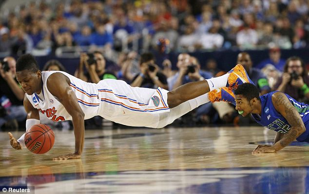 Diving for it: Gators forward Will Yeguete goes for the ball