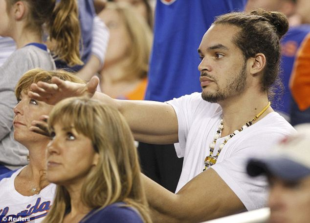 Famous fan: Joakim Noah, who playedfor the Gators before going on to the Chicago Bull's NBA team, sat on the sidelines and cheered on his alma mater