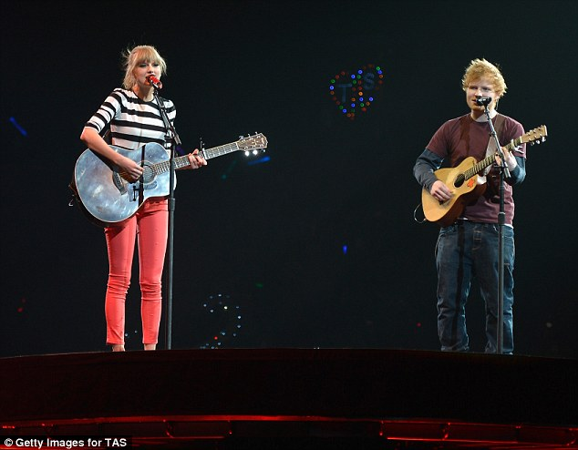 Good friends: Taylor and Ed gave a heartfelt performance as they swapped electric guitars for acoustic ones
