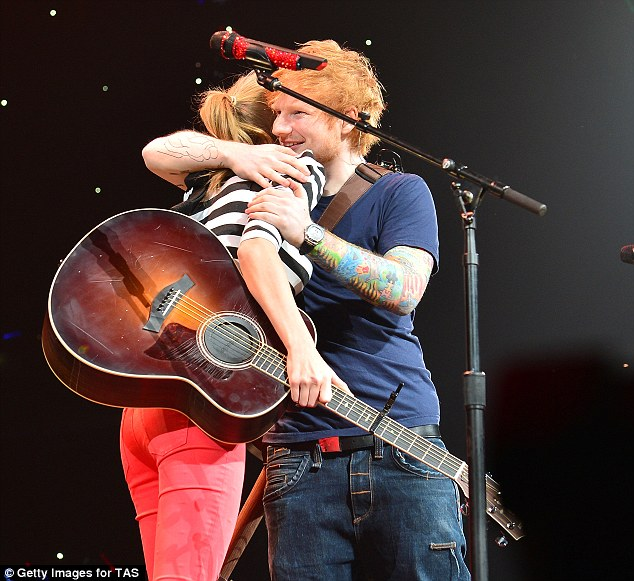 Hug it out: Taylor's friend Ed Sheeran performed alongside her, giving her a big hug afterwards