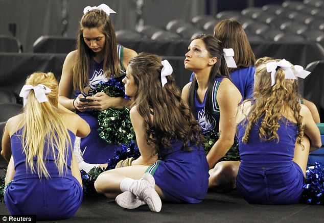 Not much to cheer about: The cheerleaders looked glum after the loss