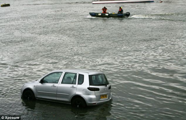 As Oxford and Cambridge rowing teams prepared for Sunday's race the Cambridge team's car became submerged on the river bank