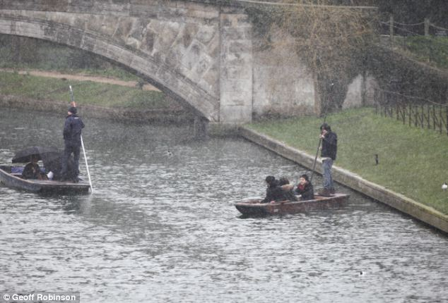 Snow flurries did not deter these tourists from enjoying themselves on the River Cam in Cambridge