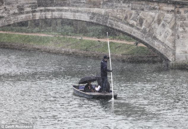 In Cambridge tourists got in the boating spirit and braved the snowy weather on the River Cam