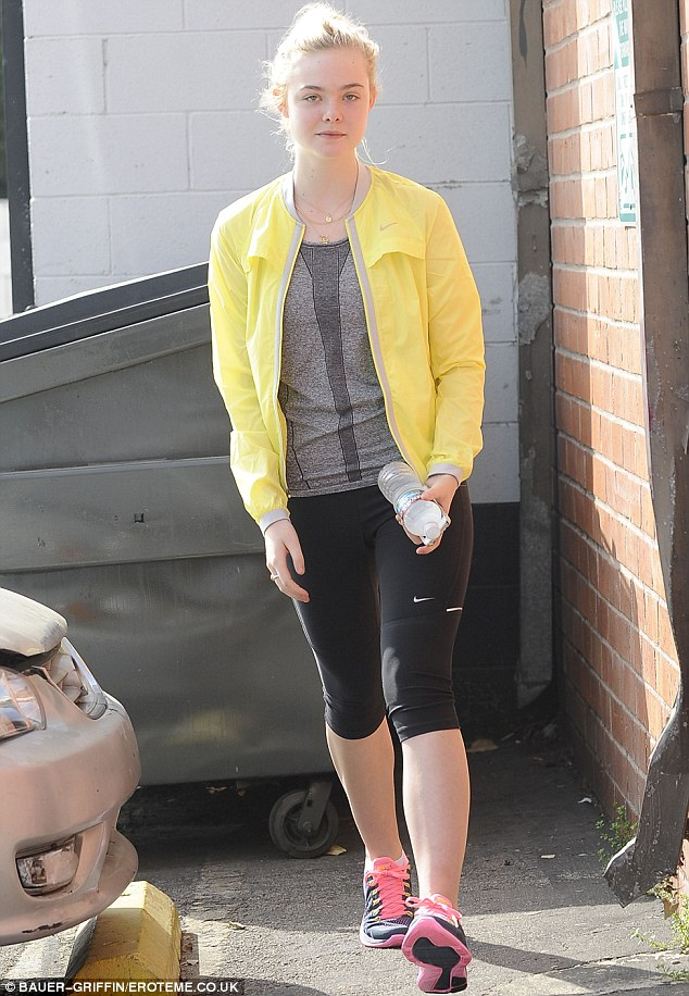 Ready to dance! Actress Elle Fanning walked into a Los Angeles dance class on Thursday in a brightly coloured jacket and trainers with neon pink accents